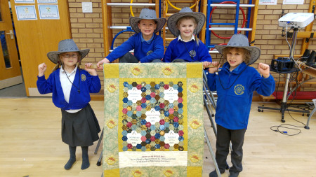 Quilt with Stow Primary pupils: L to R: Amelia Taylor, Maxwell Shurmer, Freya Molson and Solomon Bell.
